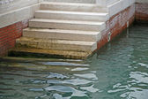 Marble stairs that descend to the sea — Stock Photo