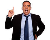 Attractive executive speaking and pointing up — Stock Photo