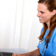 Blonde friendly nurse looking to computer — Stock Photo