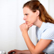 Charming pensive pretty girl looking on computer — Stock Photo