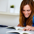Pretty blonde student woman smiling and reading — Stock Photo #11161604