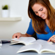 Pretty blonde student girl smiling and learning — Stock Photo
