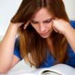 Beautiful young girl studying — Stock Photo