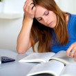 Adult pretty student girl reading a book — Stock Photo