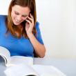 Lovely pretty woman speaking and browsing a book — Stock Photo