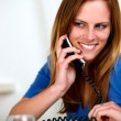 Smiling caucasian blonde girl on phone — Stock Photo