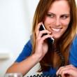 Smiling caucasian blonde girl on phone — Stock Photo