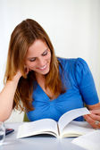 Charming pretty girl looking to a book — Stock Photo