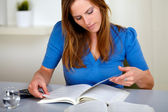 Adult pretty woman reading a book — Stock Photo