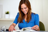 Blonde friendly young woman reading a book — Stock Photo
