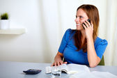 Charming blonde lady talking on mobile phone — Stock Photo