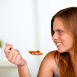 Pretty blonde woman eating healthy food — Stock Photo #11276230