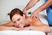 Beautiful woman getting a massage — Stock Photo
