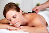Beautiful blonde woman smiling at spa — Stock Photo