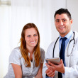 Young blonde woman with her medical doctor — Stock Photo