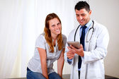 Professional medical doctor with a patient — Stock Photo