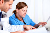 Two medical scientific looking to some documents — Stock Photo