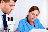 Two colleagues working at laboratory — Stock Photo
