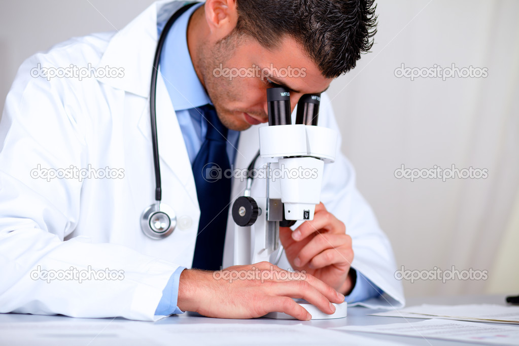 Portrait of a hispanic professional doctor with a microscope at laboratory at hospital indoor  Stock Photo #11421769