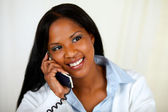 African woman conversing on phone — Stock Photo