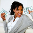 Afro-american girl holding plenty of cash money — Stock Photo