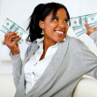 Beautiful girl holding plenty of cash money — Stock Photo
