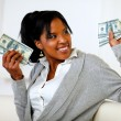 Charming young woman holding plenty of cash money — Stock Photo