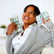 Charming woman holding plenty of cash money — Stock Photo #11763725