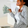 Happy woman holding plenty of cash money — Stock Photo #11764171