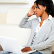Stressed young black woman working on laptop — Stock Photo #11827935