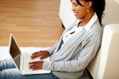 Afro-american woman using her laptop — Stock Photo