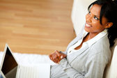 Pretty woman sitting at home on the floor — Stock Photo