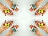 Hands releasing butterflies — Stock Photo