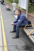 Young man waiting train — Stock Photo