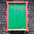 Green window on wooden textrued wall — Stock Photo