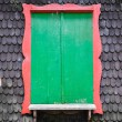 Royalty-Free Stock Photo: Green window on wooden textrued wall