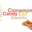 Sweets and cinnamon sticks isolated on white background - Stock Photo