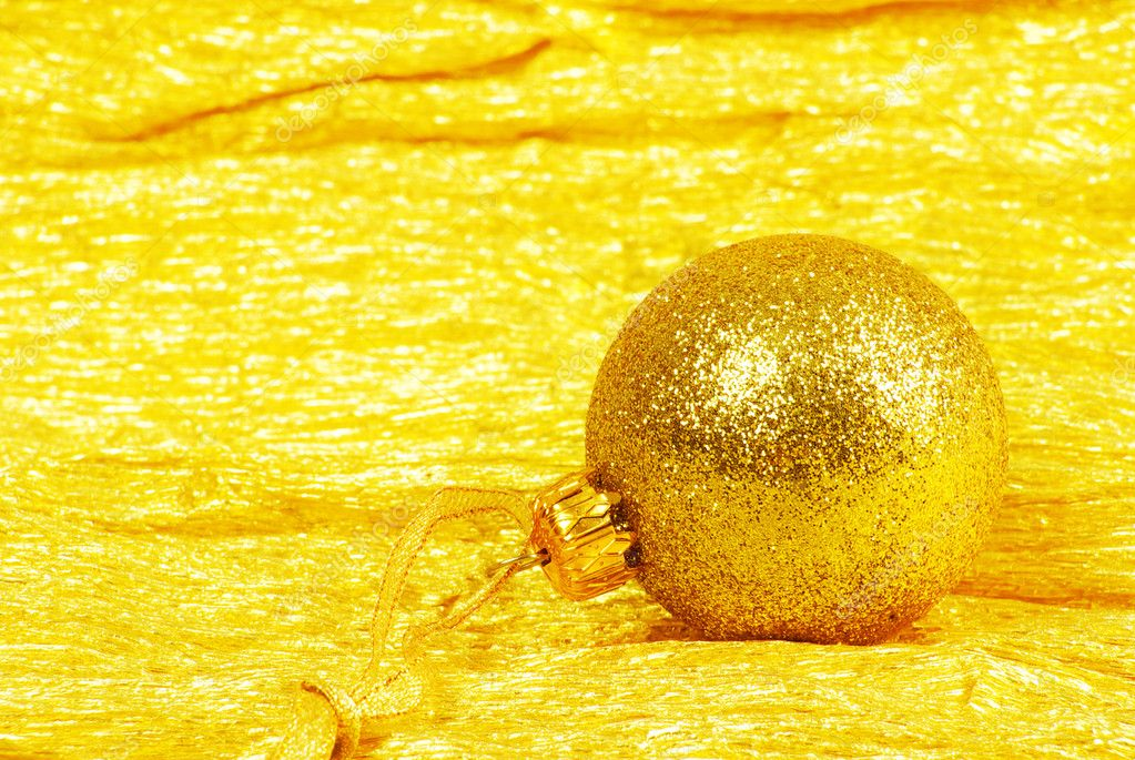 Christmas ball on golden background — Stock Photo #10864348
