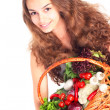Young woman with basket of vegetables — Stock Photo #11008282