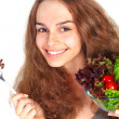 Young woman eating vegetable salad — Stock Photo #11008295