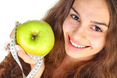 Woman with apple and centimeter — Stock Photo