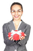 Businesswoman giving you a gift — Stock Photo