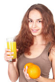 Woman with juice and oranges — Stock Photo