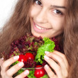 Young woman holding bowl of salad — Stock Photo #11641107