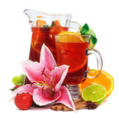 Refreshment beverage in pitcher and glass with fruits and spice — Stock Photo