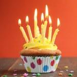 Yellow birthday cupcake full of candles — Stock Photo #11044221