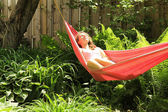 Girl lying down in a hammock — Stock Photo