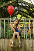 Teen with red balloon — Stock Photo