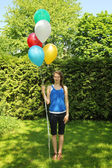 Teen holding baloons — Stock Photo