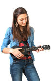 Teen playing ukulele — Stock Photo